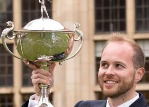 Michael Bradfield holding the PGA Assistant Trophy
